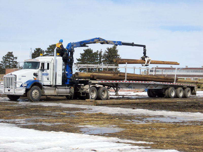 Adams Industries truck loading wood