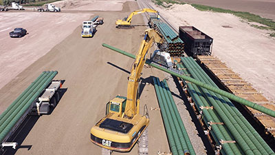 Adams Transloading Pipe on CAT Industrial Crane