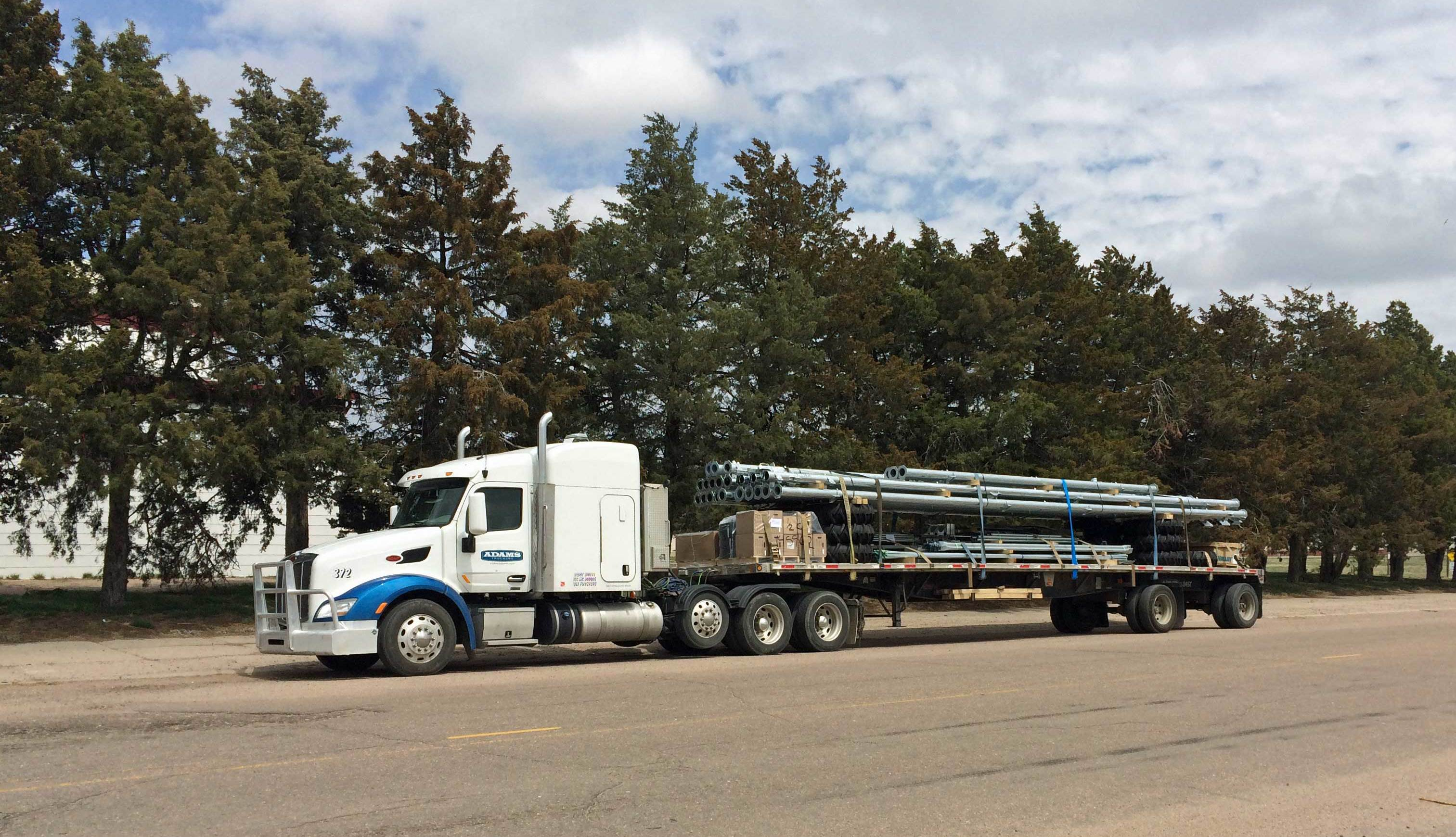 Adams Trucking - Flatbed and pnuematic trucking company